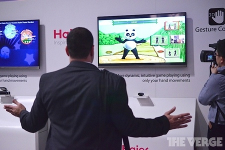 A CES-goer tries out Haier's gesture control TV