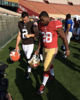 Johnny-manziel-in-full-browna-uniform-and-pads-with-carlos-hy...-on-twitpic