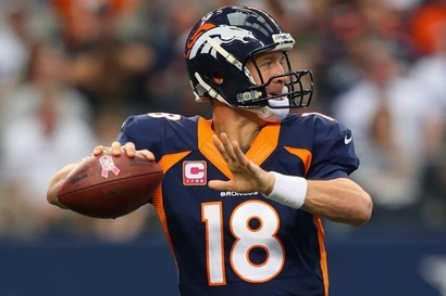 Hi-res-183457293-peyton-manning-of-the-denver-broncos-throws-against-the_crop_exact