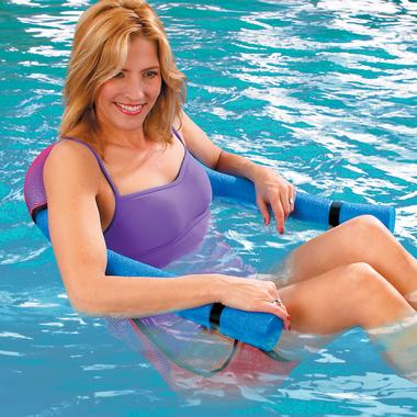 Woman sitting in the Noodle Pool Chair in a swimming pool