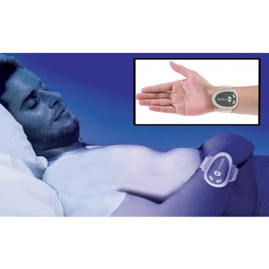 Man sleeping while wearing the Time to Stop Snoring Wristband