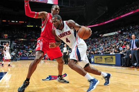 Hi-res-461712295-paul-millsap-of-the-atlanta-hawks-driving-to-the-basket_crop_north_medium