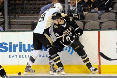 Pascal Dupuis stretchered off ice