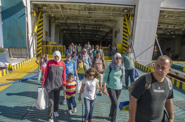 More than 2500 Syrian refugees disembark the Greek Ferry 'Eleftherios Venizelos' that brought them to the port of Pireus from the Greek islands.
