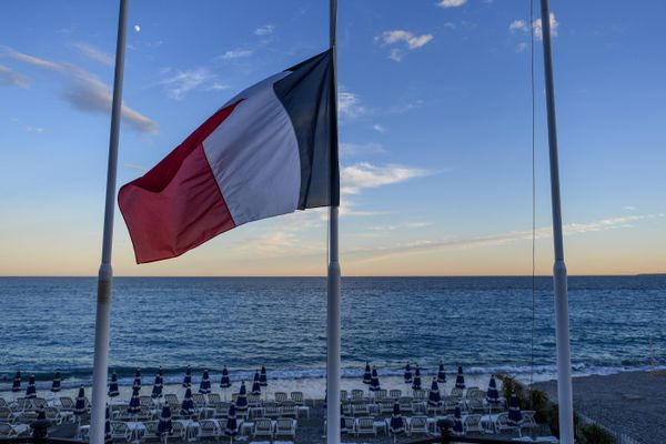 A French flag at half-mast near the beach in Nice.