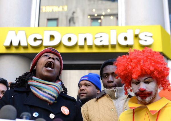 Workers protest outside a McDonald's, which could be affected by the NLRB decision