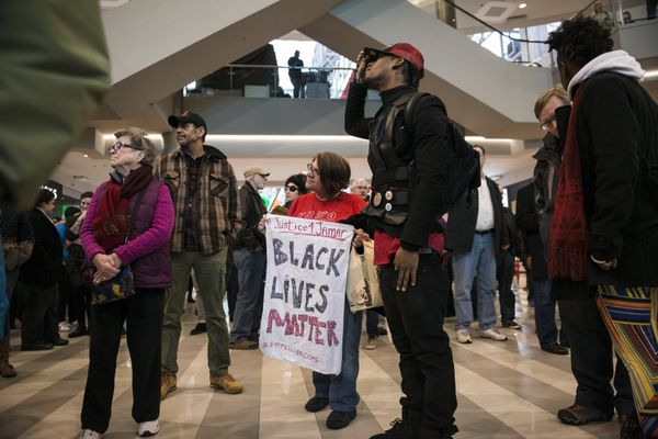 Alexander Clark, cousin of Minneapolis Police shooting victim Jamar Clark, participates in the protest at the Mall of America.