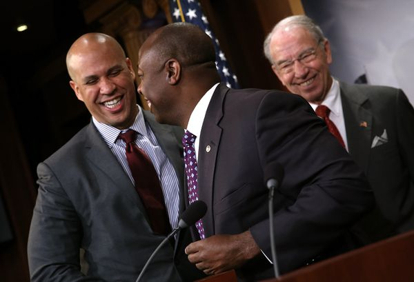 Sens. Corey Booker (D-NJ), Tim Scott (R-SC), and Chuck Grassley at a press conference unveiling the compromise bill.