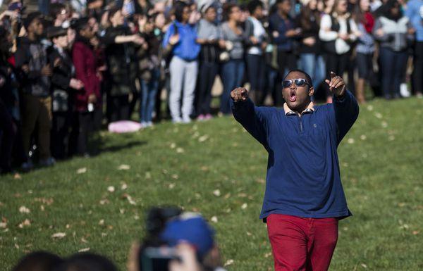 Students celebrate Wolfe's resignation.