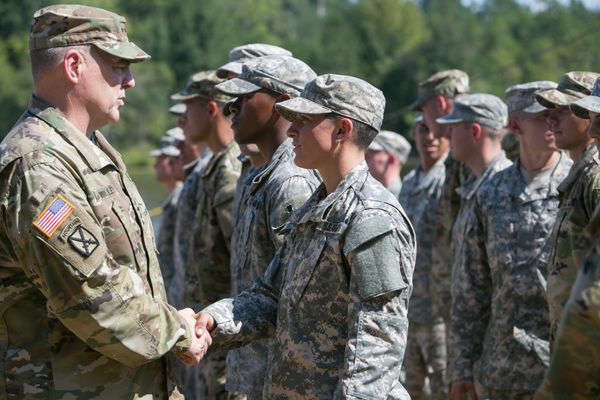 US Army Chief of Staff Gen. Mark Milley congratulates Capt. Kristen Griest during her graduation from Ranger School on August 21, 2015; Griest was one of the first two women to graduate from the school.