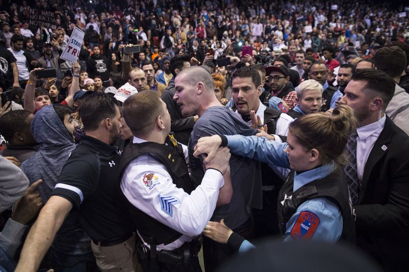 A fight between supporters and protesters at Donald Trump's aborted rally in Chicago.
