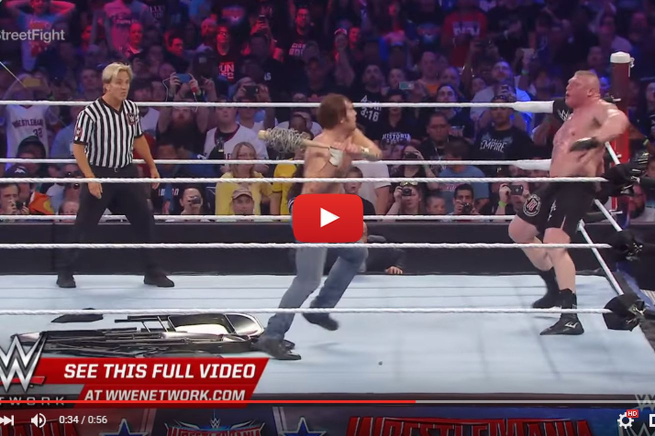WrestleMania video: Brock Lesnar attacked with barbed wire bat a la Negan from Walking Dead
