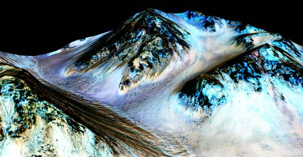 """Per NASA: """"Dark, narrow streaks on Martian slopes such as these at Hale Crater are inferred to be formed by seasonal flow of water on contemporary Mars. The streaks are roughly the length of a football field."""""""
