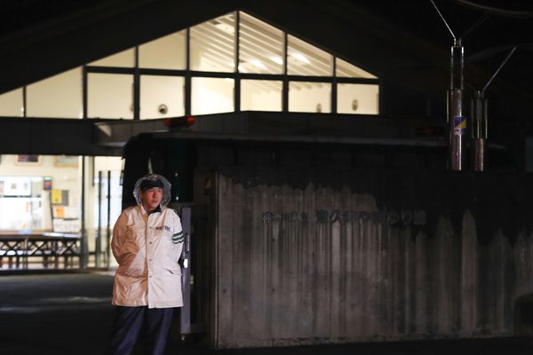 A police offer stands in front of Tsukui Yamayuri En care home in Sagamihara, Japan.
