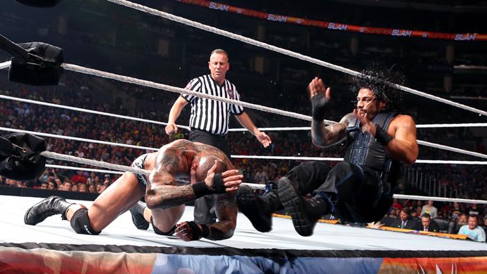 Roman Reigns delivers his trademark basement dropkick to Randy Orton