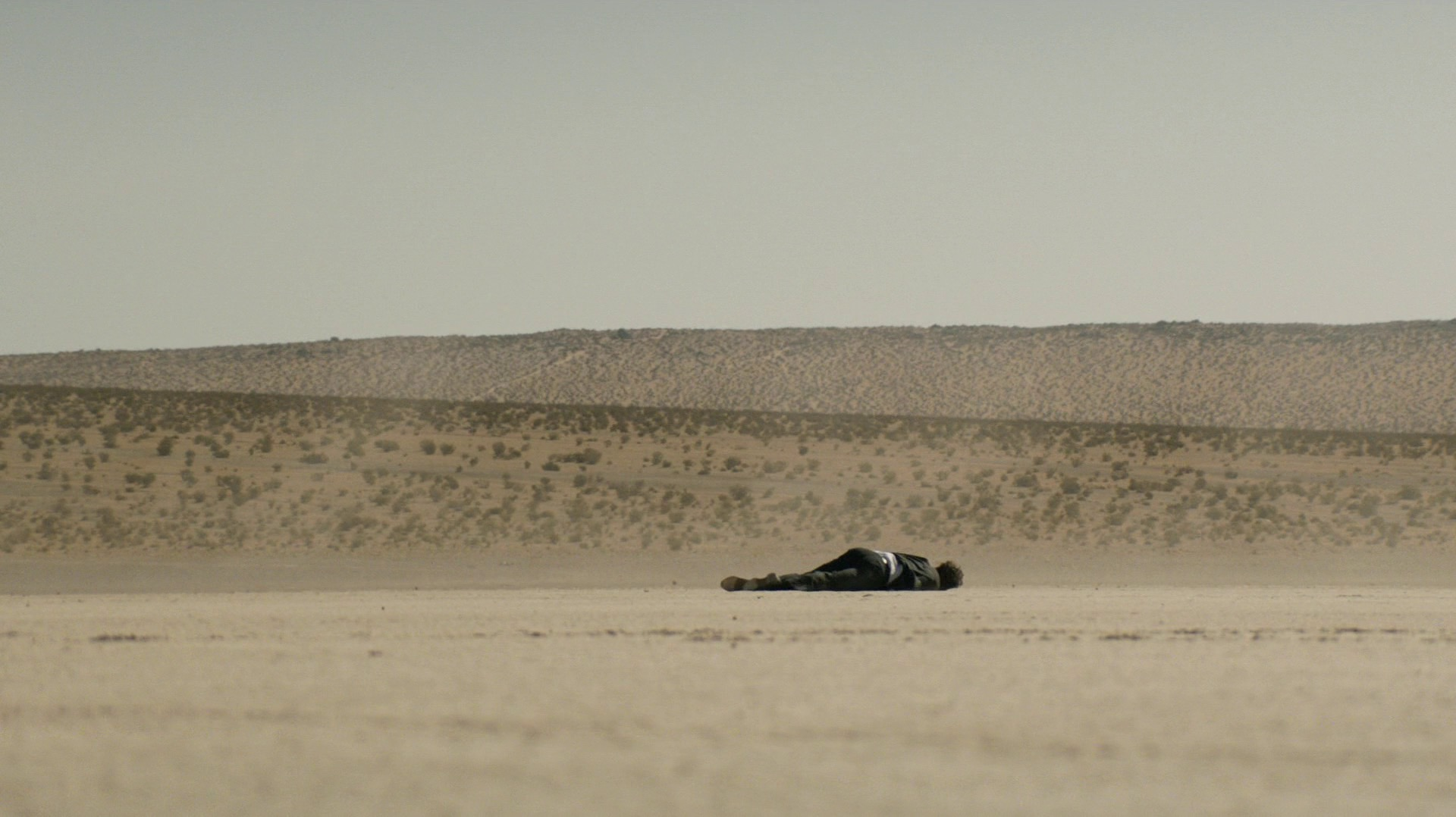 Frank, dead and alone in the desert