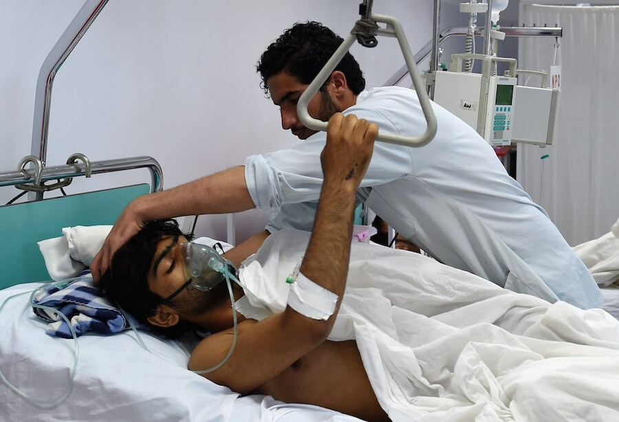 An MSF employee injured in the bombing is attended to in another hospital.