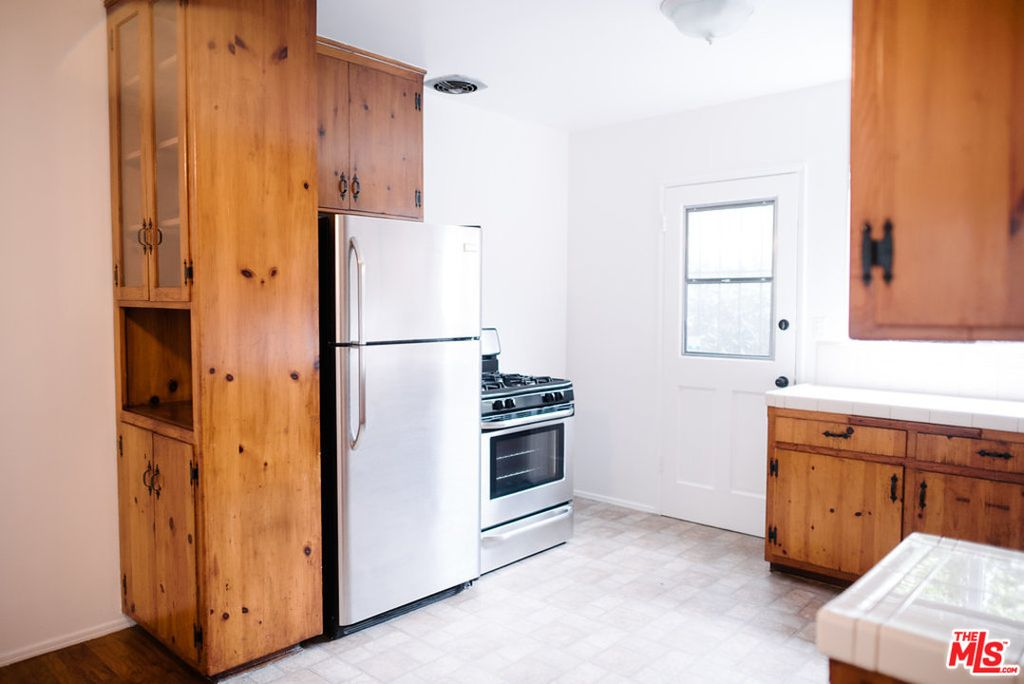 This two bedroom apartment in the NoHo Arts District neighborhood has its  own private entrance  some wood floors  and ceiling fans  Those shiny  appliances. Los Angeles rent comparison  What  2 050 rents you right now