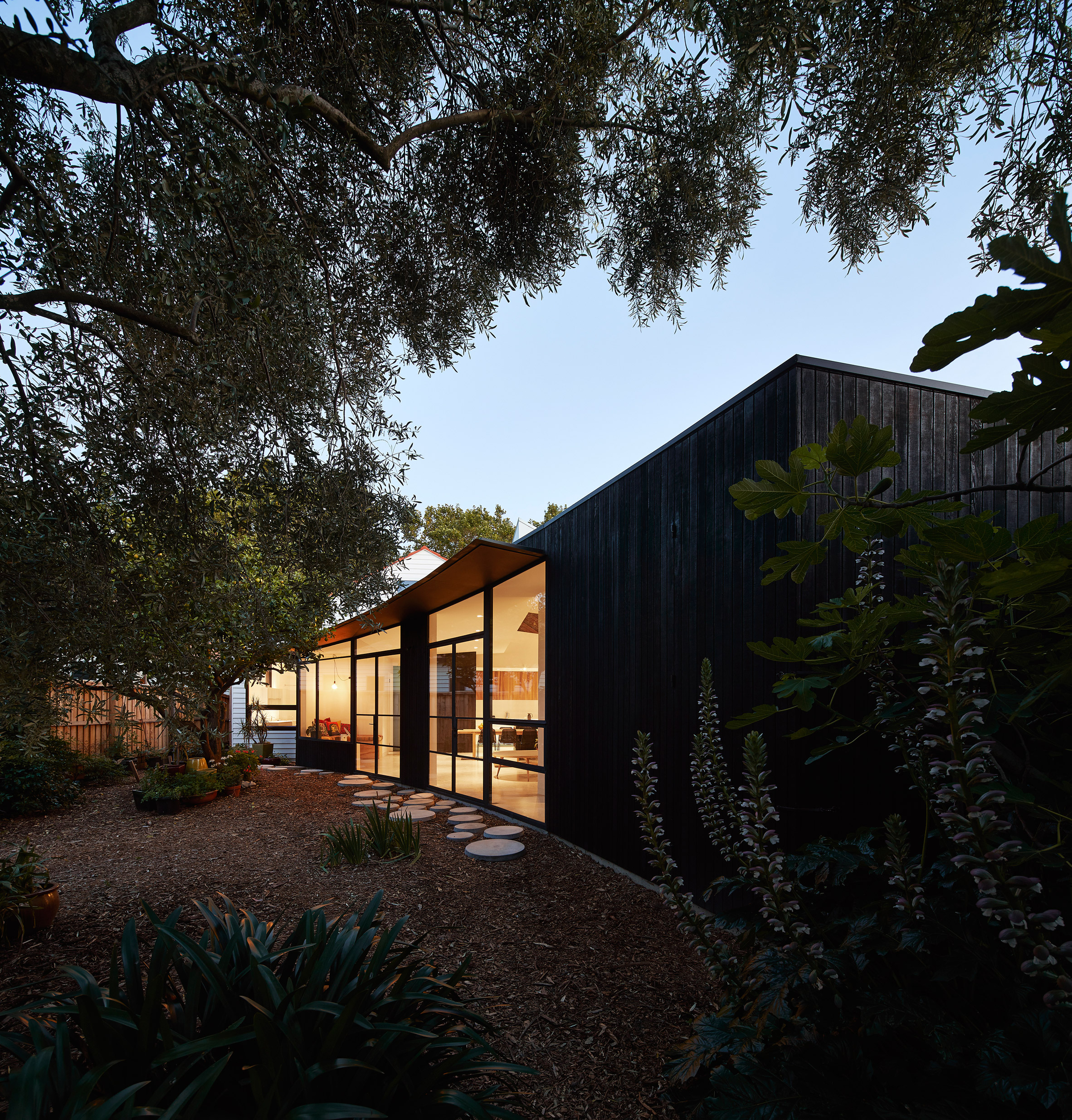 Dark Timber House Offers Refuge For Homeowner With Sleep