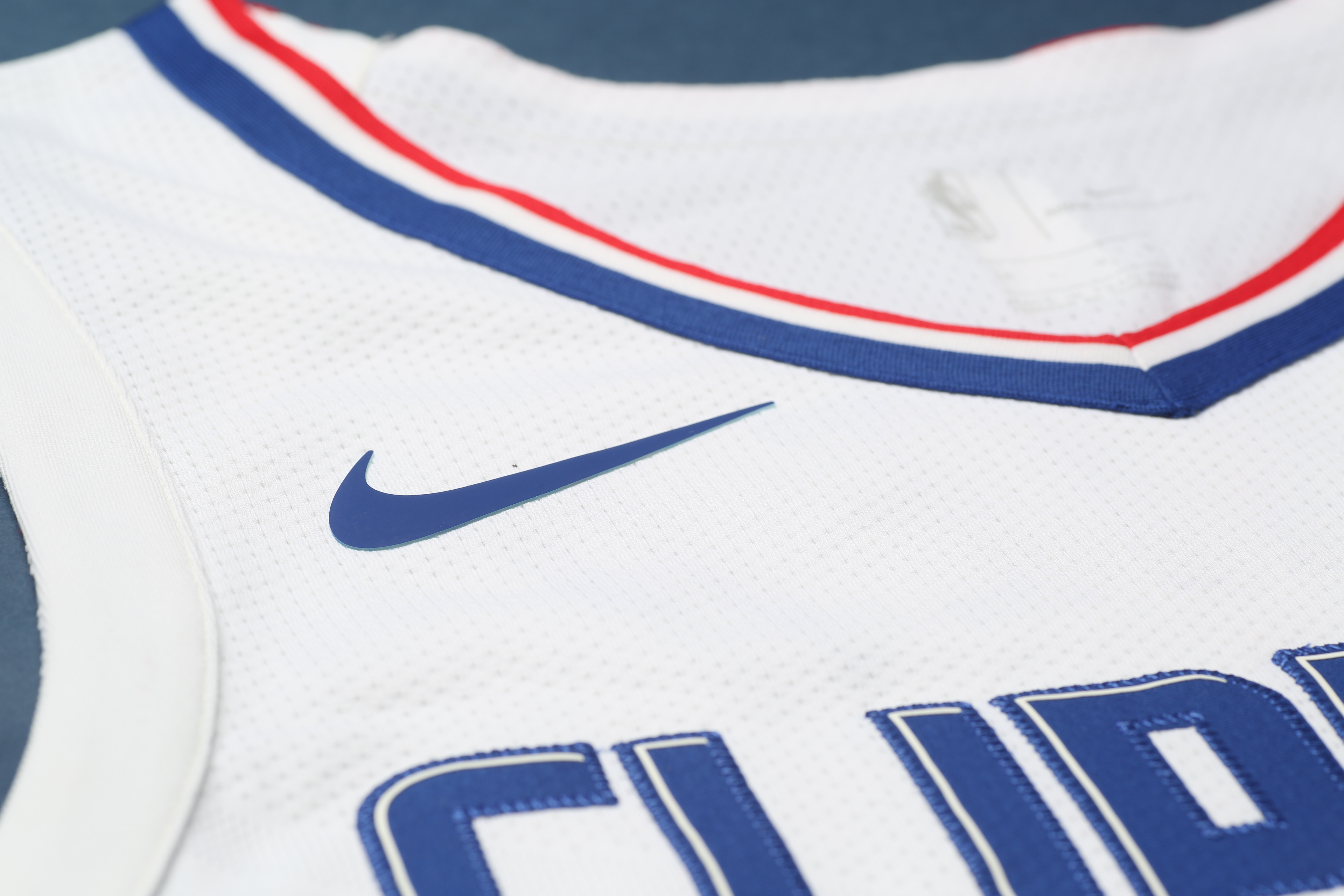 "63465b8f View of the Nike swoosh on the Clippers' new white ""Association edition""  jersey. Clippers PR"