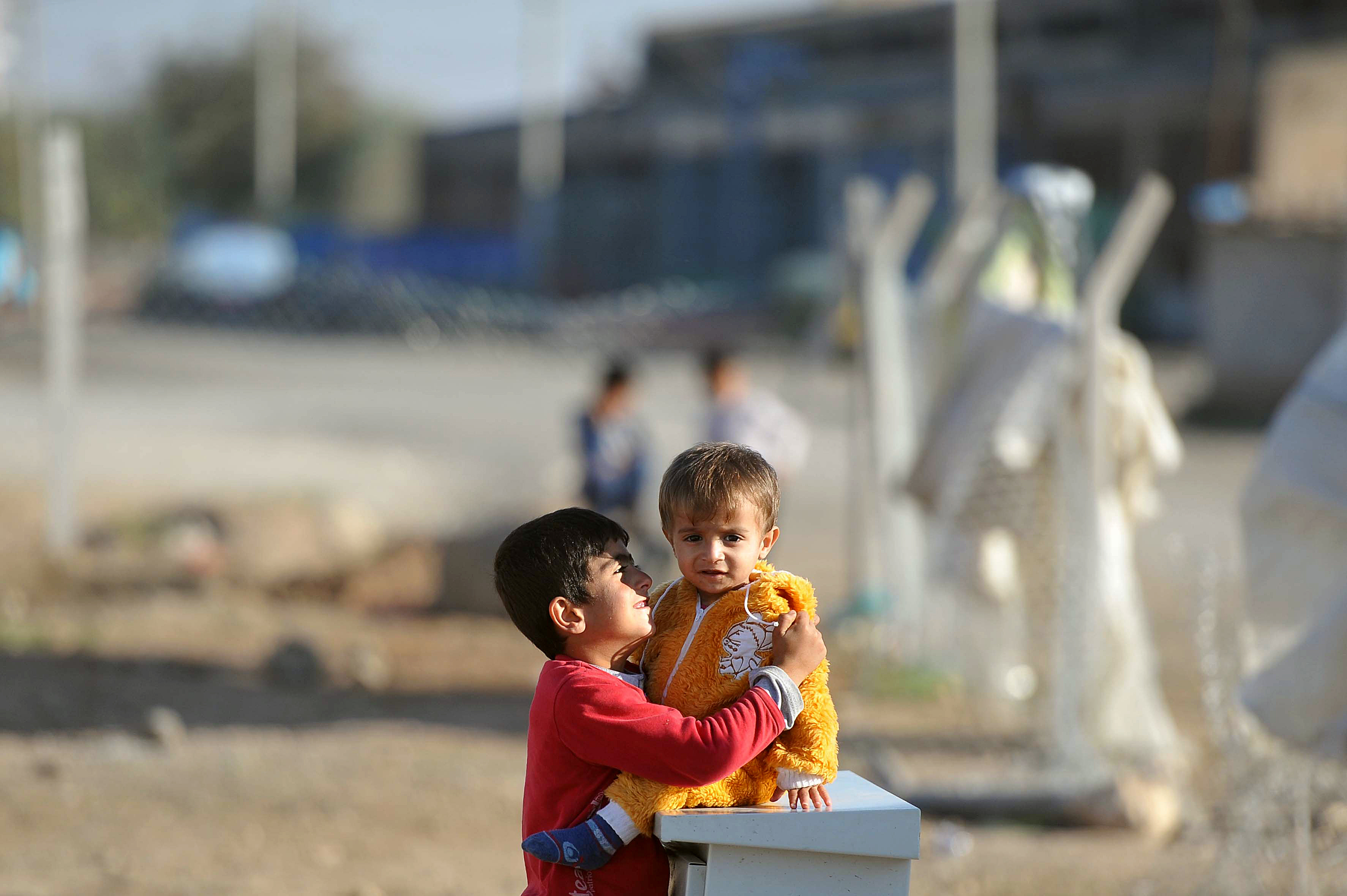 Two Kurdish brothers from Kobane, Syria in a Turkish refugee camp.